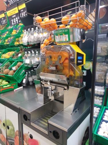 Orange juice maker at a local super market